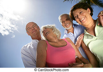 Two senior couples posing outdoors