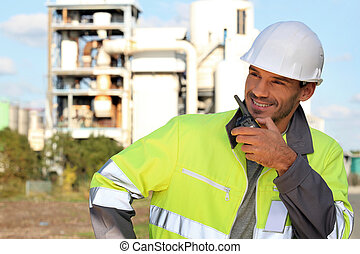 Site foreman communicating via radio receiver