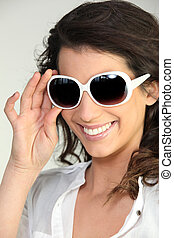 Woman wearing oversized sunglasses