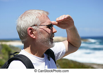 Man looking out over the horizon