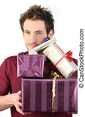 Man holding pile of gifts