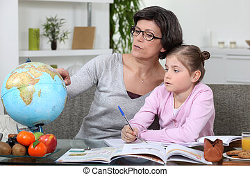 mother and young daughter doing her homework