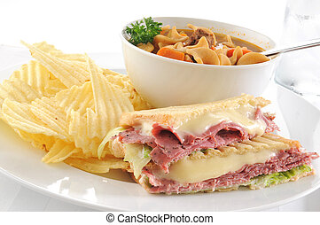 Pastrami sandwich with soup - A grilled pastrami sandwich...