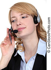 Woman wearing telephone head-set