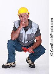 A kneeling plumber.