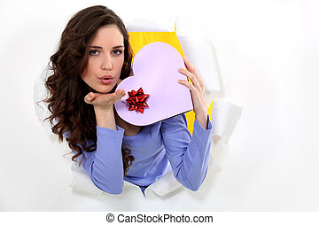 Woman with heart shaped box