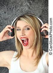 blonde music fan with piercing in tongue