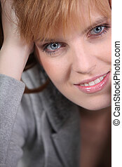 Portrait of redhead woman with blue eyes