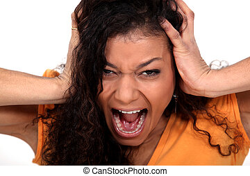 Portrait of a young woman screaming