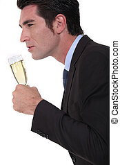 Businessman with glass of champagne