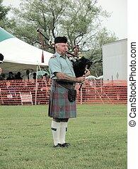 Un, escocés, flautista, tubería