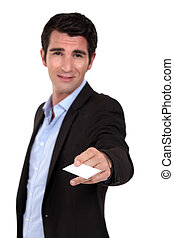 man in a suit giving his business card