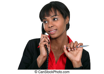 Afro-American businesswoman talking on the phone