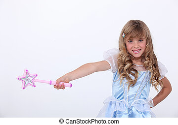 Little girl dressed as princess with wand