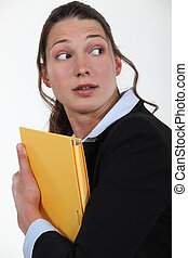 Worried woman with a file