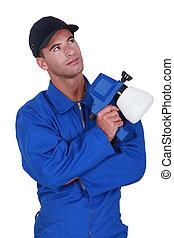 workman in jumpsuit looking upwards