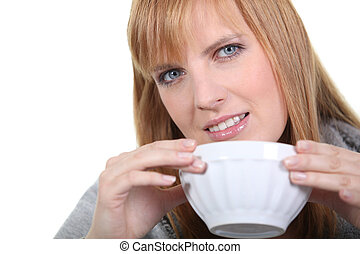 Blonde woman with bowl