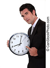 Man pointing to clock