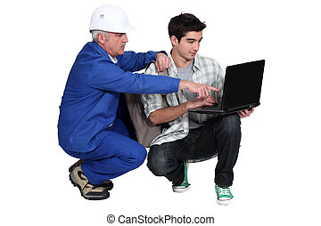 Manual worker and student with a laptop