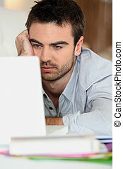 Tired man in front of computer