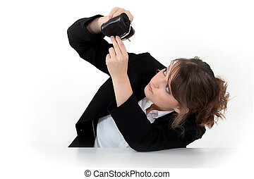 Woman looking into her coin purse for money