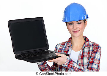 Female contractor holding laptop