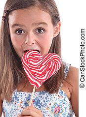 Girl eating lolly pop