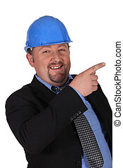 mocking man in suit wearing hard hat