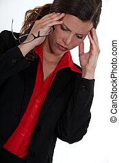 Businesswoman starting to develop headache