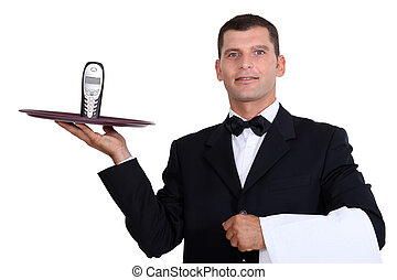 Waiter serving telephone
