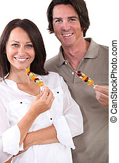 Couple with fruit skewers