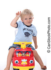 Boy sitting on toy vehicle