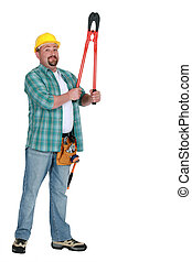 Tradesman holding up a pair of large clippers