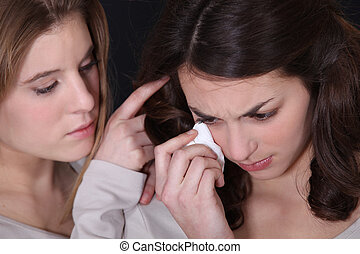 Young woman consoling a friend