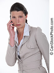 A sad businesswoman over the phone