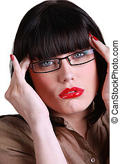 bespectacled brunette with bloodshot lips and fingers to...