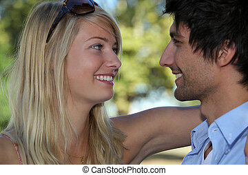 Young couple in love embracing in the sunshine