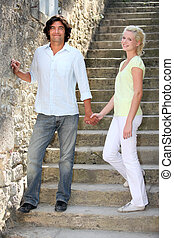 Couple standing on some old stone steps