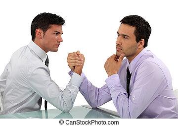 handsome businessmen arm wrestling
