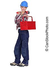 craftswoman, segurando, spanner, ferramenta, caixa