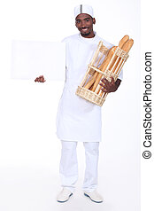 Young baker with a basket of baguettes and a board left...