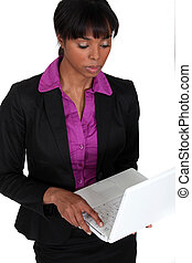 Business professional using a laptop