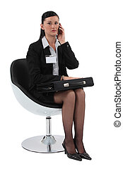 Woman waiting with a briefcase