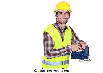 Construction worker holding a jigsaw