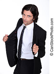 Man opening his suit jacket