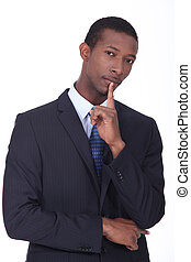 Businessman with his finger to his chin in thought