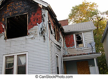 house fire damage - fire damaged home with melted siding and...