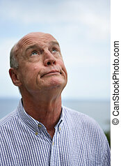 Portrait a senior man looking jaded