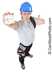 An electrician presenting an outlet.