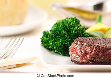 fillet mignon garnished with vegetables  ready to eat